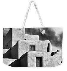 Taos Pueblo Stacks Weekender Tote Bag by Gary Warnimont