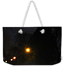 Weekender Tote Bag featuring the photograph Taxi In Full Moon by Nina Silver
