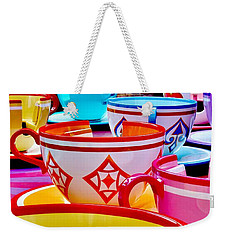 Weekender Tote Bag featuring the photograph Tea Party by Benjamin Yeager