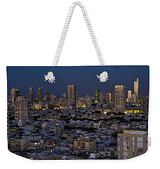 Weekender Tote Bag featuring the photograph Tel Aviv At The Twilight Magic Hour by Ron Shoshani