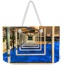 Weekender Tote Bag featuring the photograph Tel Aviv Jump by Ron Shoshani