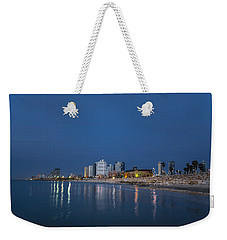 Weekender Tote Bag featuring the photograph Tel Aviv The Blue Hour by Ron Shoshani