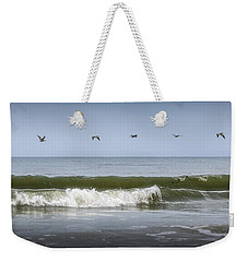 Weekender Tote Bag featuring the photograph Ten Pelicans by Steven Sparks