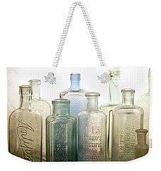 Weekender Tote Bag featuring the photograph The Ages Reflected In Glass by Holly Kempe