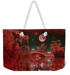 Weekender Tote Bag featuring the photograph The Blood Moon by Michael Rucker