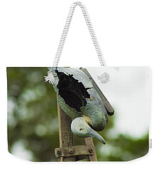 Weekender Tote Bag featuring the photograph The Broken Duck  by Naomi Burgess