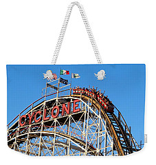 Weekender Tote Bag featuring the photograph The Cyclone by Ed Weidman