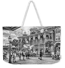 Weekender Tote Bag featuring the photograph The Emporium by Howard Salmon