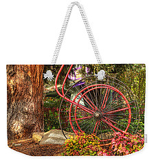 Weekender Tote Bag featuring the photograph The Fire Hose Reel by Thom Zehrfeld