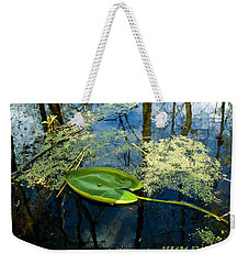 Weekender Tote Bag featuring the photograph The Floating Leaf Of A Water Lily by Verana Stark