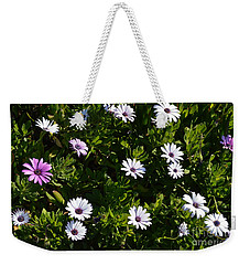 Weekender Tote Bag featuring the photograph The Garden by Laurie L