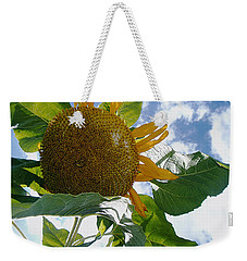Weekender Tote Bag featuring the photograph The Gigantic Sunflower by Verana Stark