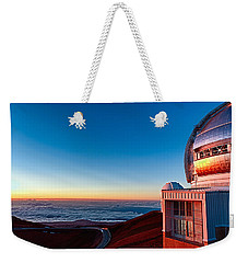 Weekender Tote Bag featuring the photograph The Glow Of The Warm Sunset Reflecting Off Of The Gemini 8.1m Op by Jim Thompson