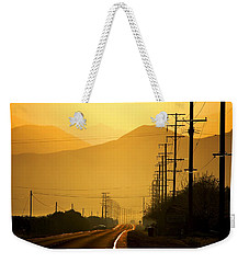 Weekender Tote Bag featuring the photograph The Golden Road by Matt Harang