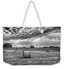 Weekender Tote Bag featuring the photograph The Hay Bails by Howard Salmon