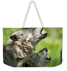 Weekender Tote Bag featuring the photograph The Howling by Wolves Only
