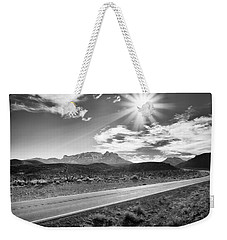 Weekender Tote Bag featuring the photograph The Lonely Road by Howard Salmon