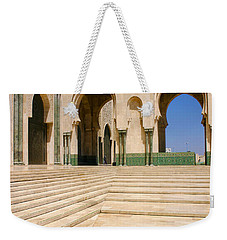 Weekender Tote Bag featuring the photograph The Massive Colonnades Leading To The Hassan II Mosque Sour Jdid Casablanca Morocco by Ralph A  Ledergerber-Photography