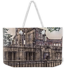 Weekender Tote Bag featuring the photograph The Memorial by Hanny Heim