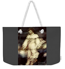 Weekender Tote Bag featuring the photograph The Metamorphosis Of A Resurrection    by Michael Hoard