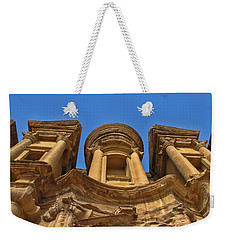Weekender Tote Bag featuring the photograph The Monastery In Petra by David Gleeson