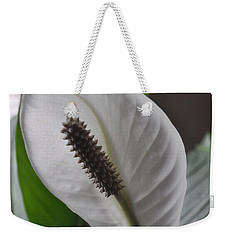 Weekender Tote Bag featuring the photograph The Peace Lily by Verana Stark
