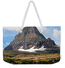 Weekender Tote Bag featuring the photograph The Peak At Logans Pass by John M Bailey