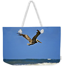 Weekender Tote Bag featuring the photograph The Pelican And The Sea by DigiArt Diaries by Vicky B Fuller