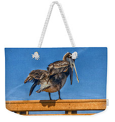 Weekender Tote Bag featuring the photograph The Pelican by Hanny Heim
