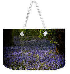 Weekender Tote Bag featuring the photograph The Pixie's Bluebell Patch by Chris Lord