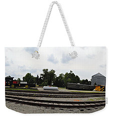 Weekender Tote Bag featuring the photograph The Railroad From The Series View Of An Old Railroad by Verana Stark