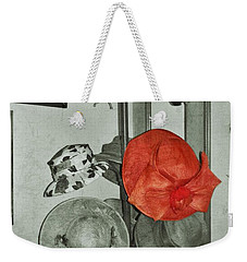Weekender Tote Bag featuring the photograph The Red Hat by Jean Goodwin Brooks