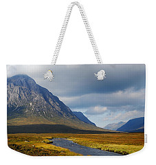 Weekender Tote Bag featuring the photograph The River Runs Through It by Wendy Wilton
