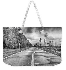 Weekender Tote Bag featuring the photograph The Road Less Traveled by Howard Salmon