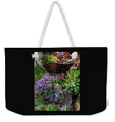 Weekender Tote Bag featuring the photograph The Whimsical Wheelbarrow by Thom Zehrfeld