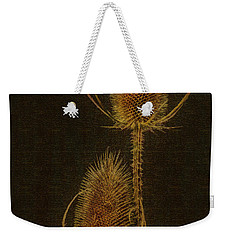 Weekender Tote Bag featuring the photograph Thistles by Hanny Heim