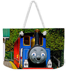 Weekender Tote Bag featuring the photograph Thomas by Sher Nasser
