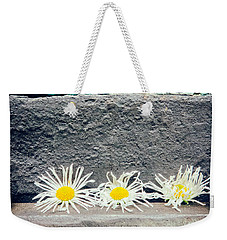 Weekender Tote Bag featuring the photograph Three Daisies Stuck In A Door by Silvia Ganora