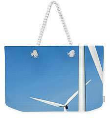 Three Mighty Windmills In A Row Against A Blue Sky. Weekender Tote Bag