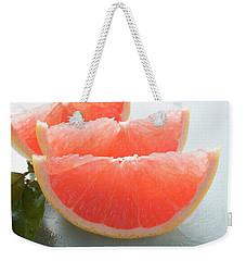 Three Pink Grapefruit Wedges, Leaves Beside Them Weekender Tote Bag