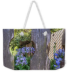 Weekender Tote Bag featuring the photograph Through The Fence by Kate Brown