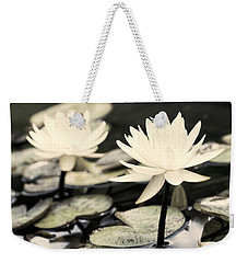 Weekender Tote Bag featuring the photograph Timeless by Lauren Radke
