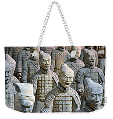 Weekender Tote Bag featuring the photograph Tomb Warriors by Robert Meanor