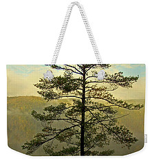 Weekender Tote Bag featuring the photograph Towering Pine by Suzanne Stout