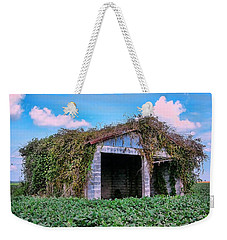 Weekender Tote Bag featuring the photograph Tractor Shack by Victor Montgomery