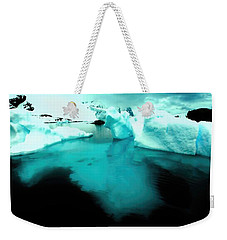 Weekender Tote Bag featuring the photograph Transparent Iceberg by Amanda Stadther
