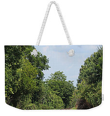 Weekender Tote Bag featuring the photograph Traxs To Anywhere by Aaron Martens