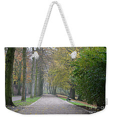 Weekender Tote Bag featuring the photograph Tree Lined Path In Fall Season Bruges Belgium by Imran Ahmed
