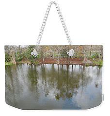 Weekender Tote Bag featuring the photograph Trees And Water by Ron Davidson
