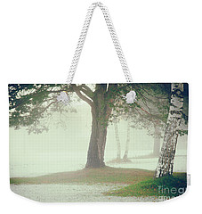 Weekender Tote Bag featuring the photograph Trees In Fog by Silvia Ganora